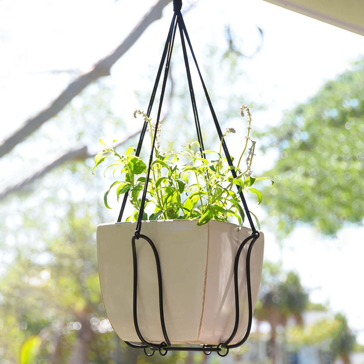 Adjustable plant hanger turns almost any pot into a for Decorative hanging pots