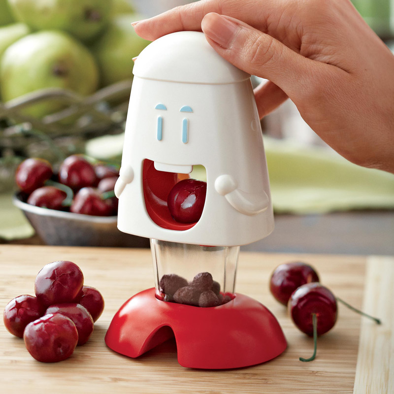 Cherry chomper cherry pitter the green head for Gadgets cocina originales