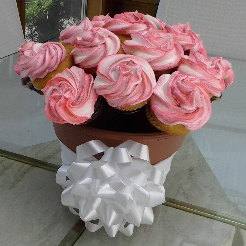 The cupcake rack create a cupcake bouquet in a flower pot the the cupcake rack create a cupcake bouquet in a flower pot izmirmasajfo