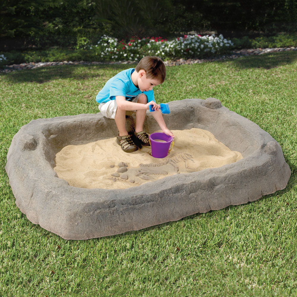 Discreet Landscaping Boulder Sandbox