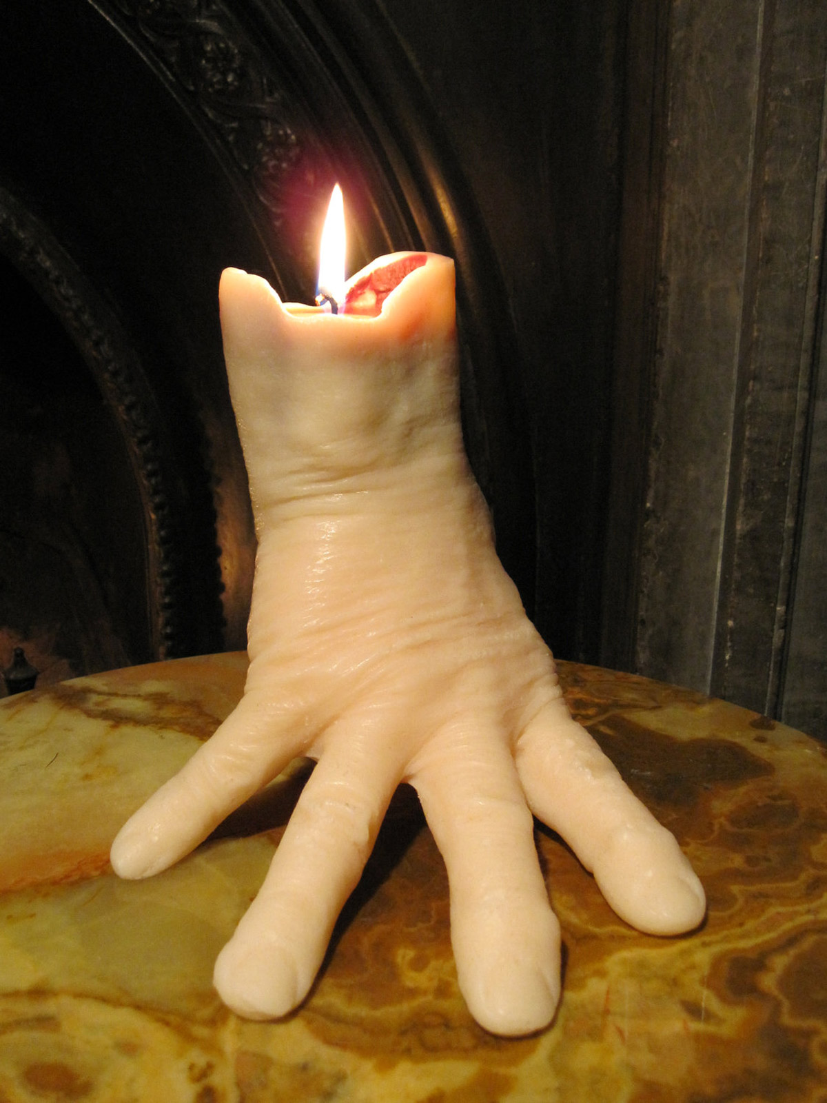 Hand candle bleeds as it burns the green head for Cool candlesticks