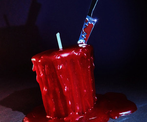Blood Scented Candle Stabbed With a Bloody Knife
