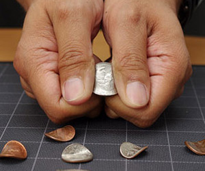 Fingers of Steel Coin Bending Trick
