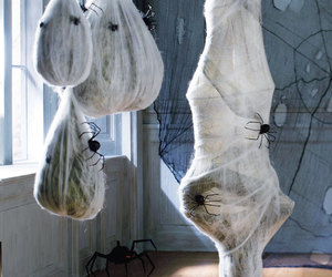 Hanging Cocooned Man and Spider Larva Balls