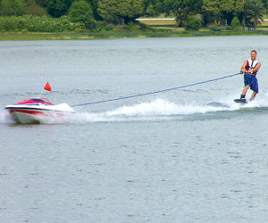 Water Skier Controlled Tow Boat