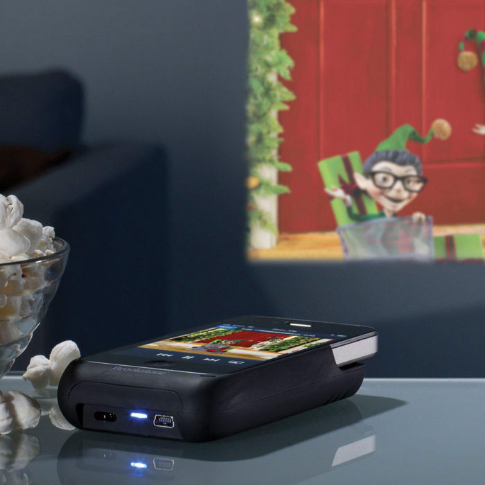 Iphone pocket projector the green head for Pocket movie projector