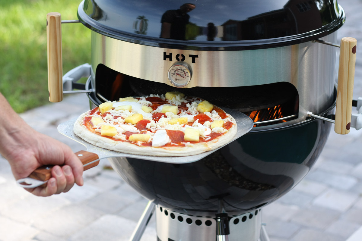 kettlepizza turns a kettle grill into an outdoor pizza oven the green head. Black Bedroom Furniture Sets. Home Design Ideas