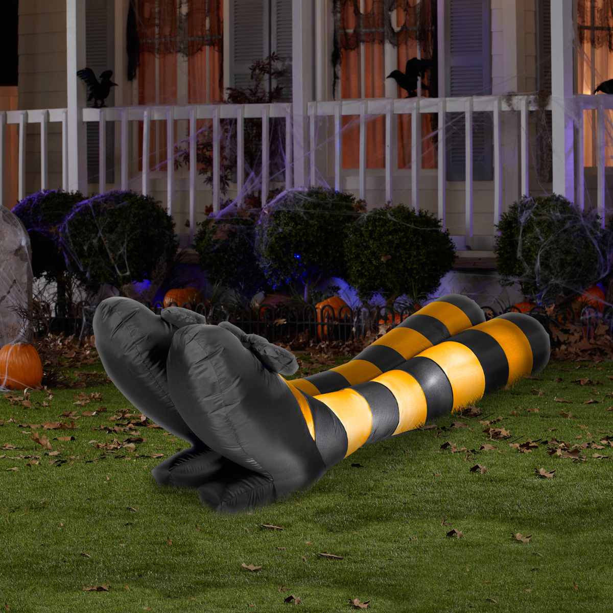 Massive inflatable witch legs the green head for Christmas cat yard decorations