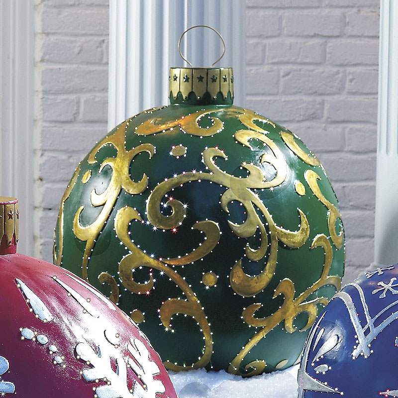 Massive outdoor lighted christmas ornaments the green head for Christmas yard decorations