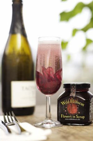 Wild Hibiscus Flowers In Syrup Bloom In Champagne Bubbles