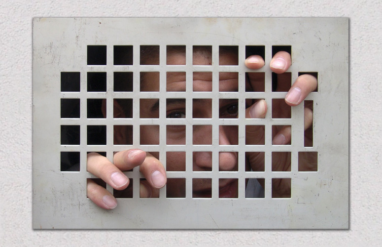 Man Trapped Behind a Wall Grate Graphic